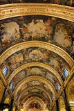 Ceiling of Saint John's Co-Cathedral, Malta. The ornate painted Baroque ceiling of Saint John's Co-Cathedral located in Valletta, Malta. The church is Royalty Free Stock Image