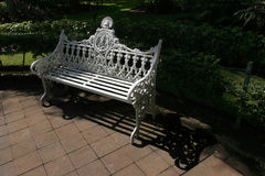 Ornate Park Bench. An old, ornate, cast-iron park bench (with many coats of paint), located in the central plaza of Colima, Mexico Royalty Free Stock Photos