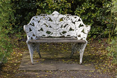 Ornate park bench. Wrought iron bench in a park setting Stock Photos