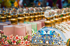 Ornate Perfume Bottles. Rows of pretty coloured perfume bottles with decoration on them Stock Image