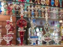 Ornate perfume bottles on a shelf Stock Photos