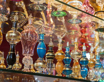 Ornate perfume bottles on a shelf Stock Images