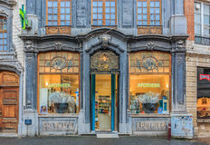 Ornate pharmacy store front. Leuven, Belgium - January 19, 2015: Ornate and beautiful vintage apothecary drugstore store front Royalty Free Stock Image