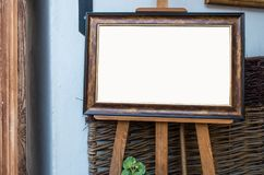 Ornate picture wooden frame on the easel in Art Gallery, Blank W. Hite  Clipping Path Stock Images