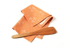 Ornate placemat and wooden spatula Stock Photo