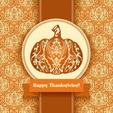 Ornate pumpkin silhouette on seamless pattern orange background Stock Photos