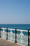 Ornate railing and sea view. View out to sea over an ornate cast iron railing Stock Photo