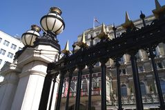 Ornate railings with lamps on lamp posts Royalty Free Stock Photo