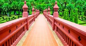 Ornate red bridge in Chiang Mai Royal Garden. Decorative bridge in Royal Garden Stock Photo