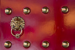Ornate on red door. Golden ornate on red door in Taiwan Royalty Free Stock Photos