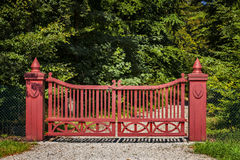 Ornate red gate Stock Photo