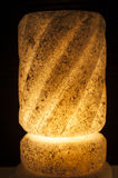 Ornate rock salt lamp on black background Royalty Free Stock Images