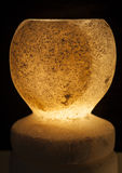 Ornate rock salt lamp on black background Stock Photo