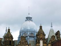The ornate roof dome and towers of leeds city market in west yorkshire against a grey cloudy sky.  royalty free stock photos