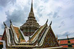 Ornate roof and spire at the historic Grand Palace in Bangkok, Thailand Stock Images