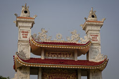 Ornate rooftop of a Chinese Buddhist temple Stock Photo