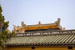 Ornate rooftop in Citadel of Hue in Vietnam. Tile dragons on ornate rooftop in Citadel of Hue, Vietnam stock images