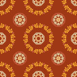 Ornate seamless floral pattern on brown background. Royalty Free Stock Image