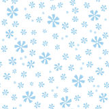 Ornate seamless pattern with small blue flowers on white background. Stock Photography