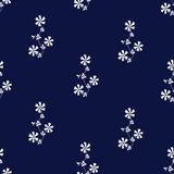 Ornate seamless pattern with the white flowers on navy blue background. Royalty Free Stock Photography
