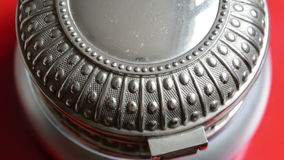 An ornate silver jewellery box. Close up of an ornate silver jewellery box stock video footage