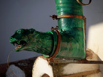 Ornate Spanish water spout. Stock Photo