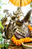 An ornate statue of Ganesha with a swastika on his hand Stock Photo