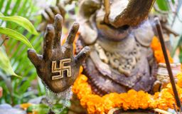 An ornate statue of Ganesha with a swastika on his hand 4 Royalty Free Stock Image