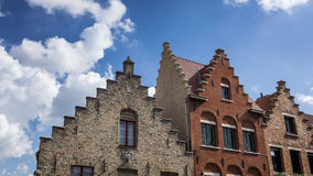 Ornate Stepped Brick Gables in Bruges, Belgium. Unique crow-stepped gables of historic houses in Bruges, Belgium Royalty Free Stock Photos