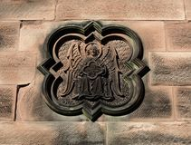 An ornate stone carving on church wall. Royalty Free Stock Image