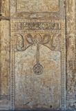 Ornate stone wall with floral patterns and calligraphy, Ibn Tulun Mosque, Cairo, Egypt. Ornate engraved stone wall with floral patterns and calligraphy, Ibn royalty free stock photo