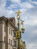 Ornate Street Lamp. Street lamp with a gilded double-headed eagle in Saint-Petersburg, Russia Stock Photo