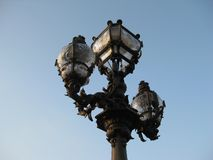 An ornate street lamp of Paris royalty free stock images
