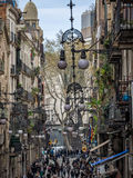 Ornate street lamps on buildings in Barcelona Stock Photos