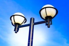 Ornate street light against a blue sky background Stock Photos