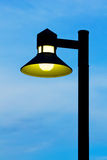 Ornate street light against a blue sky background Stock Photography