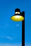 Ornate street light against a blue sky background Stock Photo