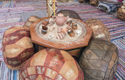 Ornate table and cushion seast at an oriental cafe Royalty Free Stock Photos
