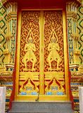 Ornate temple door, Thailand Stock Photography