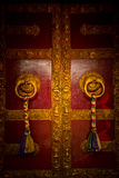 Ornate Tibetan doors of the Drubgon Jangchup Choeling Tibetan Temple, Kathmandu, Nepal Stock Image