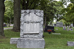 Ornate Tombstone. Old ornate tombstone in cemetery Royalty Free Stock Photos