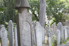 Ornate turkish headstones in graveyard Stock Photos