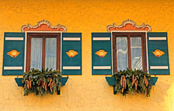 Ornate typical bavarian windows with green shutters Royalty Free Stock Photo