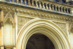 Ornate Victorian Archway. The ornate archway that covers the entrance to a historic building at a university Royalty Free Stock Photos