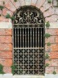 Ornate Victorian English iron gate. Wrought iron Royalty Free Stock Photo