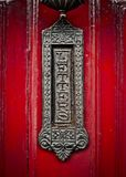 Ornate Vintage British Letterbox. Ornate Old Fashioned British Letterbox Or Mailbox On A Red Front Door royalty free stock photos