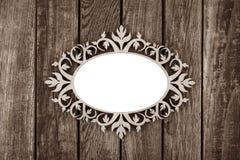 Ornate vintage frame on wooden background Royalty Free Stock Images