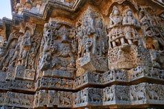 Ornate wall panel reliefs depicting Ganesha on the left and other deities, west side, Hoysaleshwara temple, Halebidu, Karnataka. v. Ornate wall panel reliefs stock photo