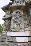 Ornate wall panel reliefs depicting Krishna dancing on the head of serpant Kalia and eventually killing him. Kedareshwara temple,. Halebidu, Karnataka, India stock photo