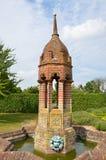 Ornate water feature in garden. Ornate brick water feature in garden Royalty Free Stock Image